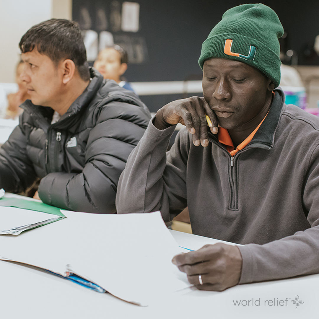 two men learning in employment class
