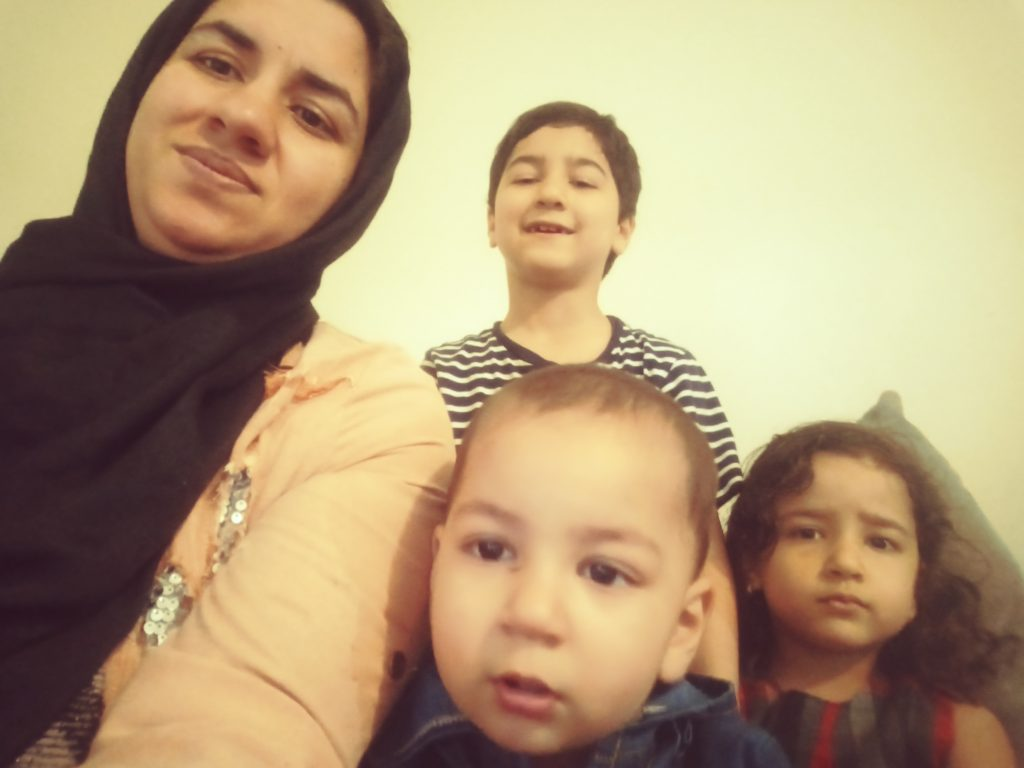A mother takes a selfie with her children