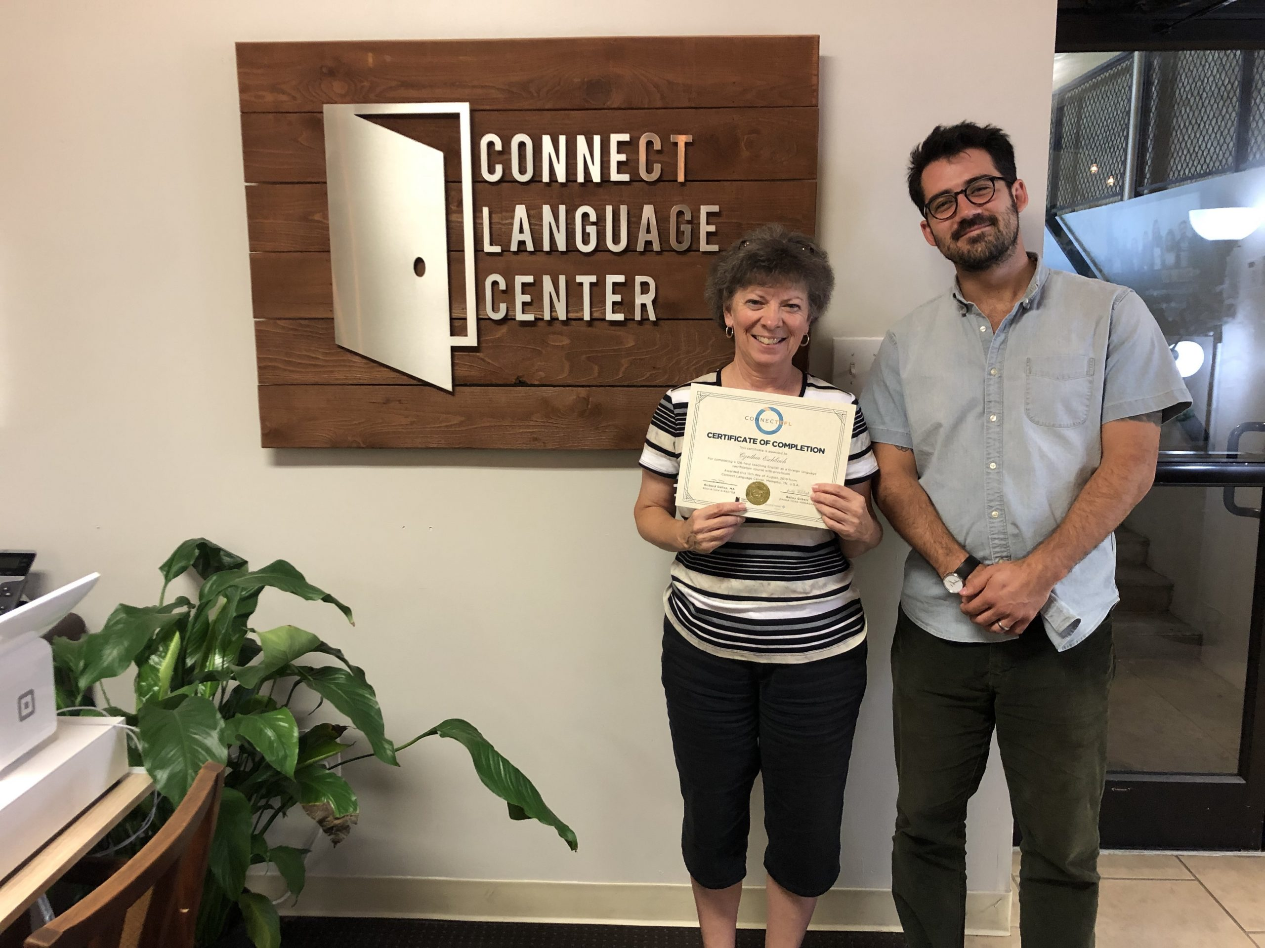 Student receives ConnecTEFL certificate.